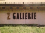 No one knows how Z Gallerie got an unofficial sign on the Brookwood Mall retaining wall.
